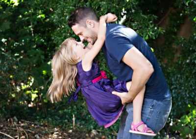 Dad and daughter playing together in outdoor photoshoot