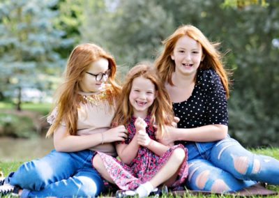 Photo of three red headed girls taken in the sunshine
