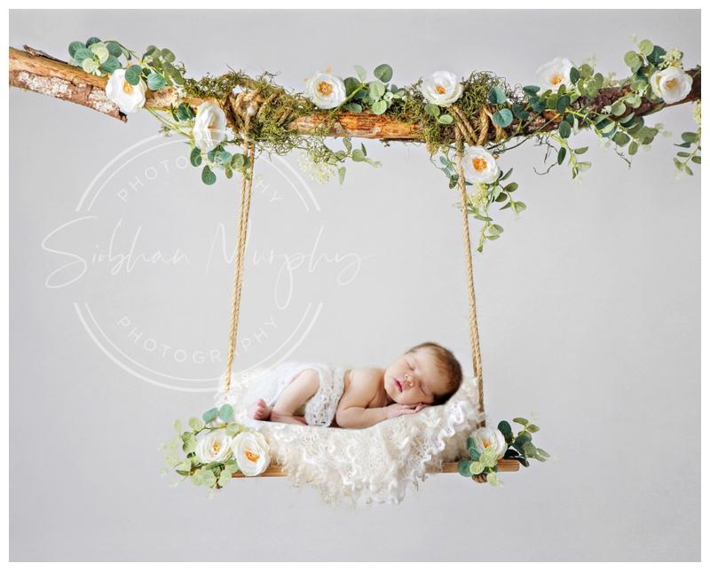 Newborn photographer in Milton Keynes baby on flower swing
