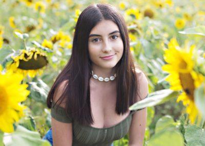 Dark haired girl in the sunflowers Lavendon Buckinghamshire